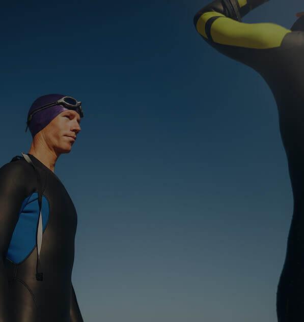 Divers wearing triathlon wetsuit