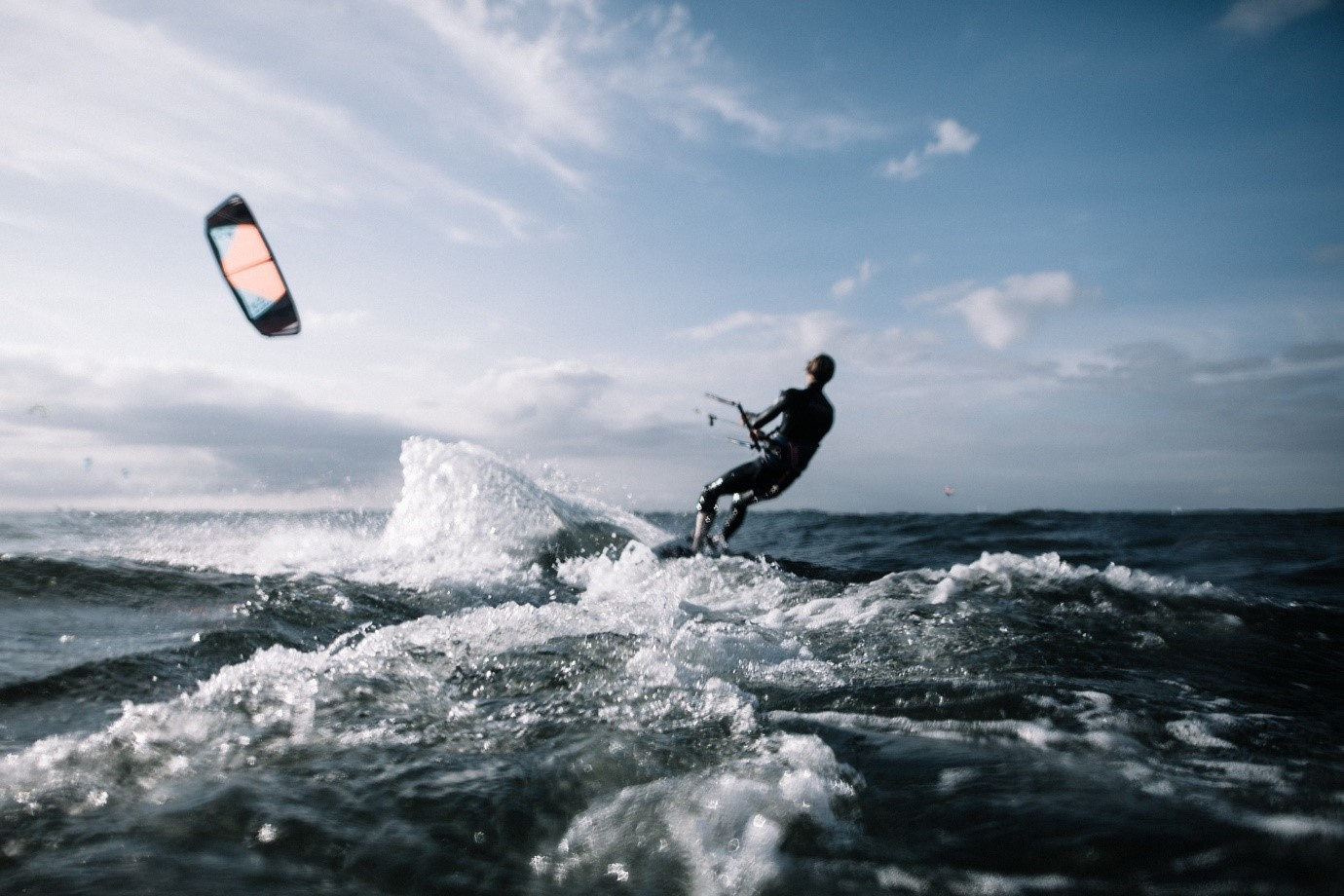 Men doing kitesurfing in UK on a sunny day
