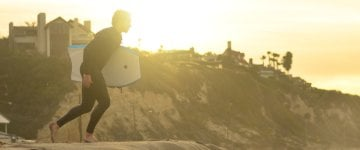 Enjoy surfing on a sunny day with wetsuitcentre exclusive summer wetsuits