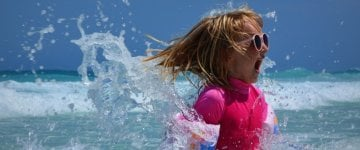 Sun protection tops to protect kids from UV rays on beach